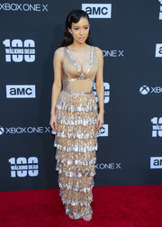 Christian Serratos was '20s-glam in a nude J. Mendel gown with a tiered skirt and silver sequin embellishments at the 'Walking Dead' 100th episode celebration.