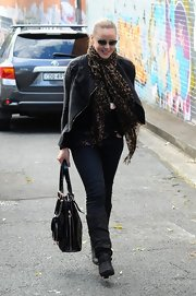 Abbie Cornish left a yoga class wearing slouchy black leather boots.