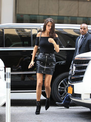 Adriana Lima rounded out her all-black look with a pair of lace-up boots.