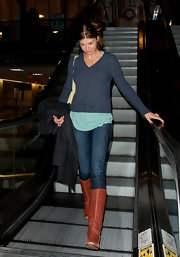 Adrianne Palicki layered a heather blue sweater over a trendy mint top at LAX.