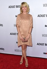 Going for total shine, Katie Aselton paired her dress with gold ankle-strap sandals.