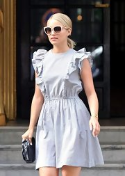 Dianna sported a pair of pink shades with a slight cat eye shape. So darling!