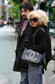 Pop star Christina Aguilera was spotted out with her family doing some shopping in SoHo. She Kept things low key in acid washed jeans, but added some flair with a studded chain strap bag.
