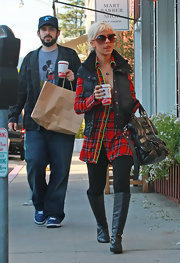 While out with husband Jason, Christina looked cozy in her plaid shirt and black leggings. She completed her winter look with a pair of flat black boots.