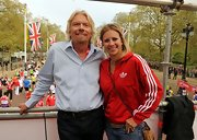 Holly Branson wore a simple ensemble at the Virgin London Marathon featuring a red track jacket.