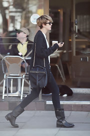 Agyness Deyn strolled through Primrose hill carrying a black leather shoulder bag with a gold strap.