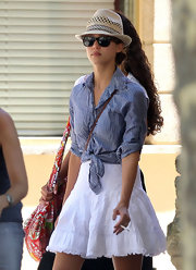 Jessica dressed in comfy vacation wear and topped off her look with a straw fedora.