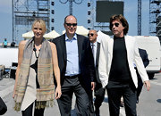 Charlene Wittstock wore a long brightly colored scarf while meeting with composer Jean Michel Jarre before her wedding.