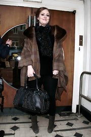 Adele carried a black studded leather bag for her visit to BBC Radio One.