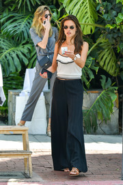 Alessandra Ambrosio teamed her top with black wide-leg pants by Kenneth Cole.