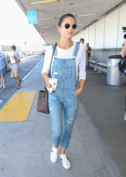 Alessandra Ambrosio was spotted at LAX looking cute in ripped denim overalls.