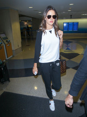 Alessandra Ambrosio stayed relaxed in a raglan sweatshirt for a flight.