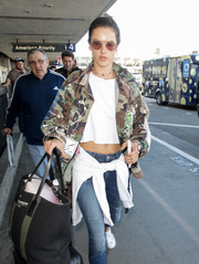Alessandra Ambrosio teamed round shades with a camo jacket and skinny jeans for her edgy airport look.