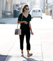 Alessandra Ambrosio took a stroll wearing a breezy black jumpsuit.