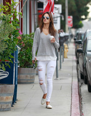 Alessandra Ambrosio teamed her top with ripped skinny jeans by Frame.
