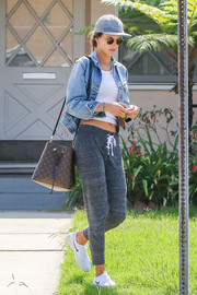 Alessandra Ambrosio teamed a denim jacket with a crop-top for a day out in Santa Monica.
