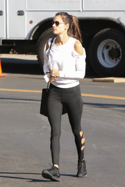 Alessandra Ambrosio was sporty and trendy in a white cold-shoulder sweatshirt while out in LA.