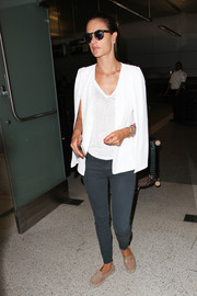 Alessandra Ambrosio arrived at LAX looking relaxed in dark gray skinny jeans and a white V-neck tee.
