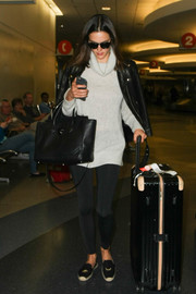 Alessandra Ambrosio caught a flight at LAX wearing a cute pair of Soludos x Jason Polan smoking slippers.