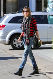 Alessandra mixed and matched prints with her striped sweater and 'Fight the Ladykiller' scarf.