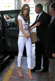 Alessandra showed off her tiny figure in these skinny white jeans.