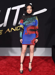 Lana Condor paired her dress with black platform sandals by Jimmy Choo.