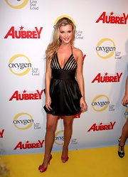 Joanna Krupa added a girlish touch to her look at the 'All About Aubrey' launch with magenta satin peep toes adorned with bows.