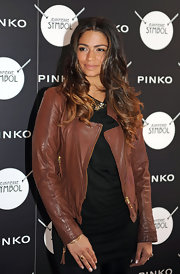 Camila Alves wore her tresses center-parted with dark roots that transitioned into golden brown curls.