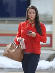Aly Raisman sported a casual red blouse with puffy sleeves and a bow at the neck while heading out in Massachusetts.