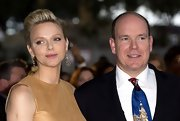 Charlene Wittstock arrived at a fashion show wearing her cropped tresses swept back in a sleek style.