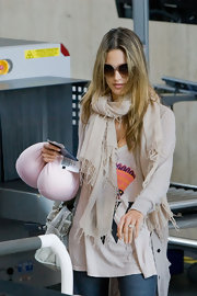 Alessandra Ambrosio wore an ivory pashmina scarf wrapped around her neck at LAX.