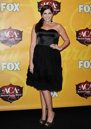 Hillary changes her outfit at the ACAs and dons a little black corset dress.