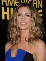 Dawn Olivieri attended the 'American Hustle' premiere wearing a voluminous curly 'do.