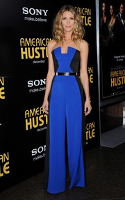 Dawn Olivieri oozed '70s chic at the 'American Hustle' premiere in a strapless blue and black jumpsuit with flared pants.