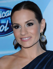 Kara DioGuardi paired her one-shoulder dress with a pair of gemstone earrings.