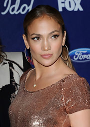 Jennifer Lopez attended the 'American Idol' finalists party wearing ultra-long feathery false lashes.
