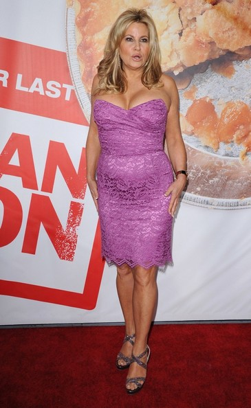 Jennifer Coolidge stepped out at the 'American Reunion' premiere in this pink lace cocktail dress.