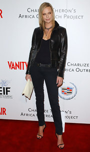 Charlize went for a casual-chic red carpet ensemble at the Vanity Fair Africa benefit in a brown leather jacket and black pants.
