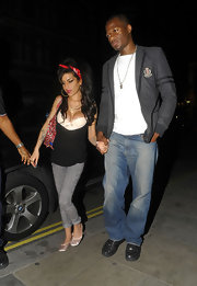 Amy wore a voluminous hairstyle accessorized with a red bandanna.