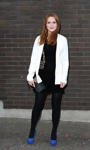 Olivia Hallinan paired a white blazer over her black dress for a cool color-blocked look.