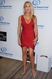 Nude Louboutin peep-toe platforms paired perfectly with Linda Thompson's red dress.