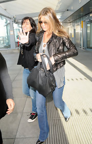 "Jennifer Aniston drew quite the crowd when she hit London's Heathrow Airport - or maybe it was just her killer Salvatore Ferragamo ""Knot Bag"". Aniston is a longtime fan of the brand and it's easy to see why."