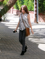 Anna Kendrick stepped out wearing a sleeveless gray print blouse.