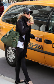 Annalynne adds a pleasant pop of color to her all black outfit, that is sure to make all the girls green with envy.