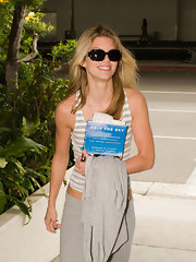 AnnaLynne was casual in a striped tank and sweats with dark oval sunglasses.