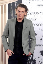 Jamie Campbell Bower brightened up his dark ensemble with a gray tweed jacket.