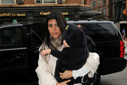 Kim Kardashian goes shopping at Scoop, accompanied by her sister Kourtney.  Kourtney is carrying her son Mason Dash Disick (b. Dec 14 2009) who appears to be wearing a Halloween costume.