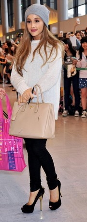 Ariana Grande looked cozy and chic in a white crewneck sweater and black skinnies as she arrived at Narita Airport.
