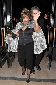 Tina Turner's metallic gray fur cape added that final rockstar touch to an already fitted and shimmery look.