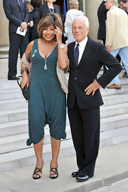 These black strappy sandals were a delicate finishing touch for Tina Turner's on-trend jumpsuit.